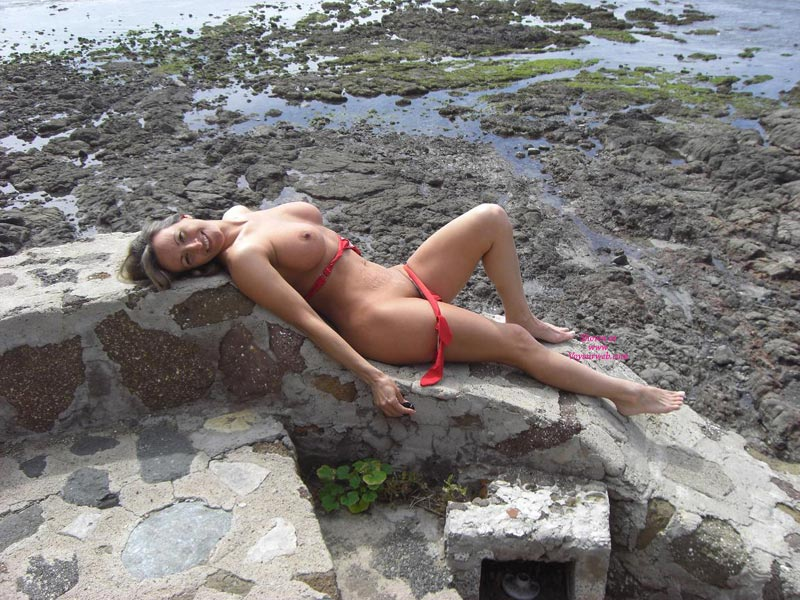 Pic #1 - Wife Exposed Tits And Pussy - Topless, Nude Wife , Pretty Smile, Smiling Into Cam, Naked On The Wall, Red Bikini, Big Boobs, Nude Outdoors, Topless Wife, Nude Wife On Messy Beach, Reclining Naked, Lying On Back