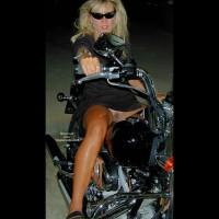 Girl Spreading Legs On Motorcycle - Black Dress, No Panties