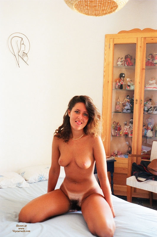 Pic #1 - Nude Wife Kneeling On Bed - Dark Hair, Huge Tits, Tan Lines, Nude Amateur, Nude Wife , The Black Forrest, Tongue Out, Mouth Watering Bush, Let's Have A Quickie, Dark Bush, Angle With Full Bush, Big Bush
