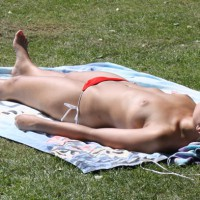 Young Girl Sunbathing Topless