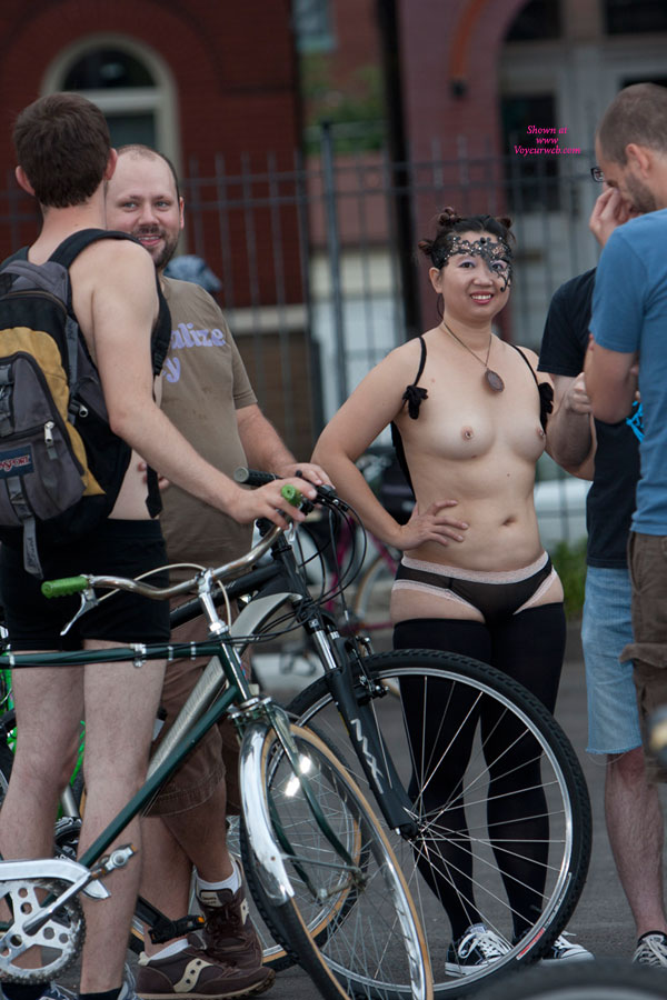 "Pic #1 - WNBR - Stl 2011 , Saint Louis' Fourth Annual World Naked Bike Ride ([[WNBR|WNBR]]). Lots Of Fun For All. ""Naked"" Is Not Literal - It Is A ""Bare As You Dare"" Theme. The Event Is Still Going In Popularity. More Guys Stripped Down Than Gals, But As You Can See, The Gals Were The Interest. All Shapes And Sizes. More Images Will Be Posted In The [[PlayGround