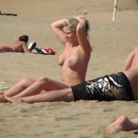 Pierced Nipples Voyeured On Beach - Big Tits, Blonde Hair, Large Breasts, Long Hair, Navel Piercing, Pierced Nipples, Topless Beach, Beach Tits, Beach Voyeur