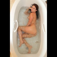 Tiffini: sexy nude girl lying sideways in tub