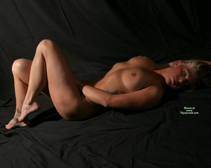 Pic #1 - Blonde Lying Naked On Black Photo Backround Canvas - Blonde Hair, Naked Girl, Nude Amateur , Studio Pose With Side Lighting, Statuesque Body, Nude Sexy Blonde, Completely Nude, Nude On Black Sheet Reaching Into Crotch, Full Soft Breasts, Inverted Nipple, Dreaming Girl Naked On Black Sheet, Eyes Closed, Side Tattoo, Toes Pointing, Lying On Back