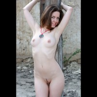 Pale Redhead At Post - Blue Eyes, Landing Strip, Naked Girl , Pale Skin, Showing Her Shaved Armpits, Perfectly Round Breasts, Hands Up, Landing Strip Pussy Hair, Medium Titties