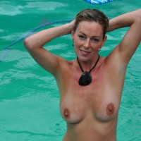 Nude Chick In Pool Hands Behind Head - Large Aerolas, Large Breasts, Naked Girl