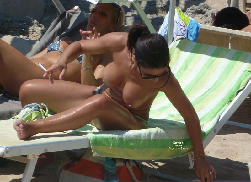 Pic #1 - Beach Voyeur - Big Tits, Milf, Beach Voyeur , Well Tanned, Dark Ponytail, Beach Milf, Reaching In Sun Lounger, Large Tits