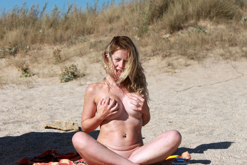 Pic #1 - Nude Handbra Babe On The Beach - Big Tits, Blonde Hair, Long Hair, Nude Beach, Beach Voyeur, Nude Wife, Sexy Wife , Big Round Tits, Bit Tits, Sitting On The Beach, Pierced Belly Button, Hand Bra, Blonde Posing Outdoors, Bellybutton Piercing