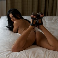 Lying On Belly And Ass Up - Black Hair, Heels, Long Hair, Topless