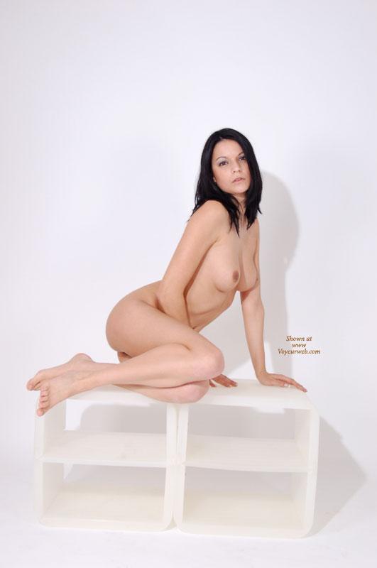 Pic #1 - White Background - Black Hair, Full Nude , White Background, Fully Nude, Sexy Nude Brunette, Black Hair, Dark Haired Naked Pose On White Shelves, Studio Shot, Sensual Poser With Naked Breasts