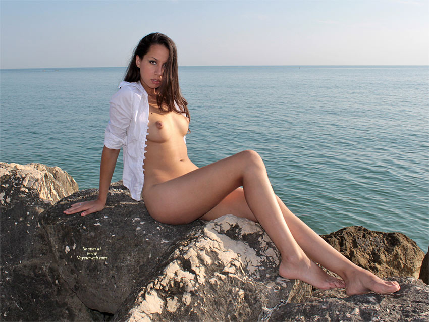Pic #1 - Bottomless Girl With Open Shirt On Rock - Brunette Hair, Dark Hair, Long Legs , Bedroom Eyes, Nude Friend, On A Rock, Straight Brunette Hair, Puffy Aerola, Nice Feet, Nude On The Rocks, Round Tits