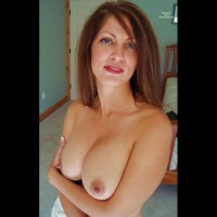 JulieK: topless milf holding her titties