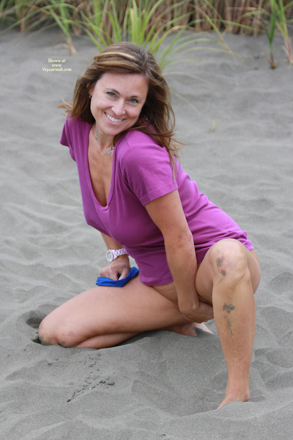Pic #2 Gettin Naked In The Sand