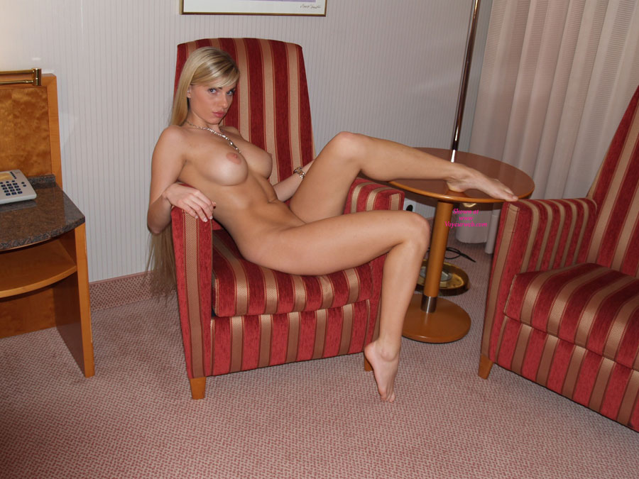 Nude Girl Sitting On Chair Leg