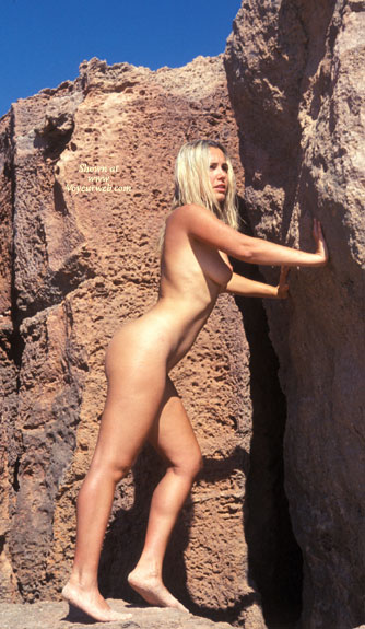 Pic #1 - Holding Up Rock Wall - Long Legs, Naked Outdoors, Nude Outdoors , Holding Up Rock Wall, Outdoor Nude, Pushing Rock, Nude Blonde Outdoors, Naked Outdoors, Outdoor Nude Blonde, Allover Tan, Long Legs, Natural Light