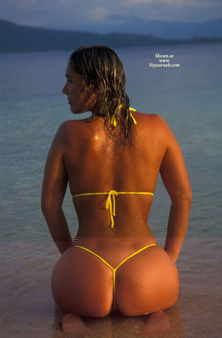 Pic #1 - At The Beach - At The Beach, Rear View, Round Ass , At The Beach, Round Ass, All Over Tan, String Bikini At Sunset, Yellow String Bikini, Yellow Mikrokini, Kneeling In Water, Rear Shot