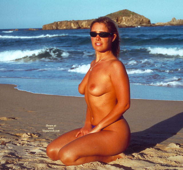 Pic #1 - Kneeing On The Beach - Nude Beach, Small Tits, Sunglasses, Topless Girl, Beach Voyeur, Nude Amateur , Kneeing On The Beach, Topless Girl, Sunglasses, Small Titties, Waves In The Background, On Knees, Medium Boobs, Nude, Beach, Pierced Belly