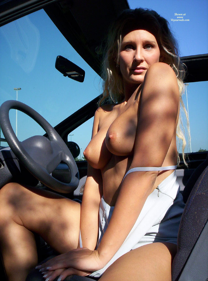 Pic #1 - Topless Milf In Drivers Seat - Blonde Hair, Long Hair, Milf, Topless , Dear In The Bright Lights, Sitting Topless In The Car, White Top Pulled Down, Green Eyes, Boobs In The Drivers Seat, Topless In The Car, Topless Blonde, Topless Milf