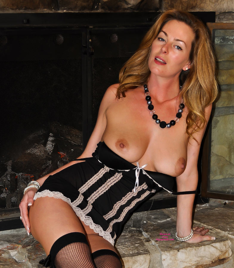 Milf wife by fireplace naked
