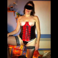 Wife Puts On Her Cupless Corset
