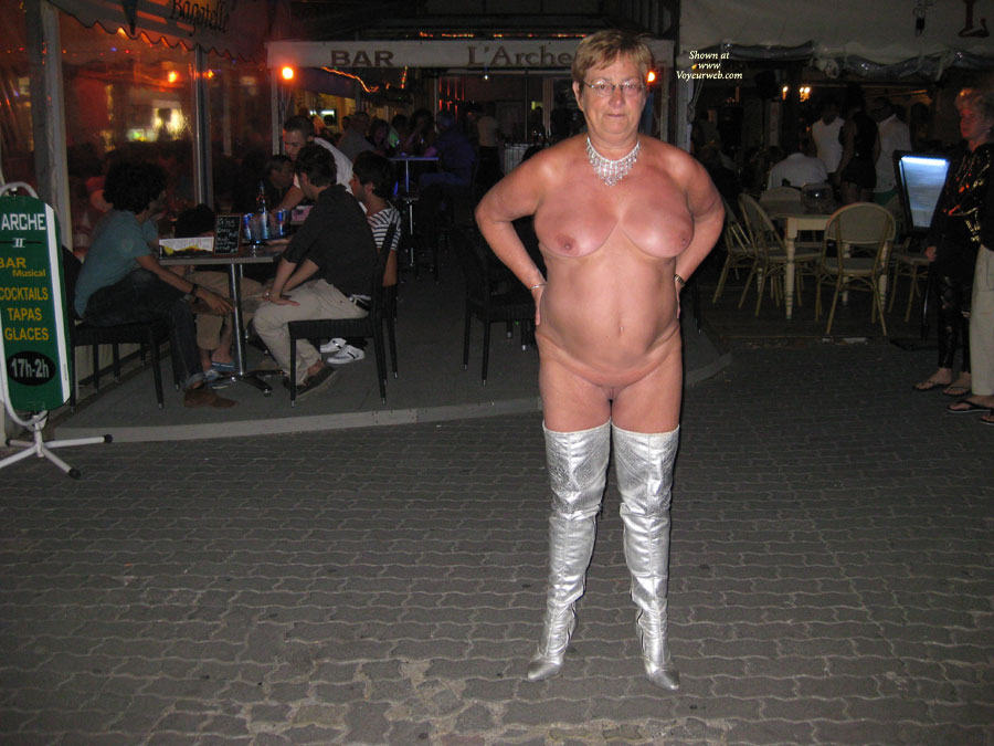 In front of a bar naked in the evening