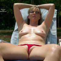 Nc_lady Sunning And Rubbing