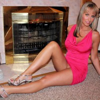 Milf Seated Pantieless In Front Of Fireplace - Blonde Hair, Heels, Long Hair, Long Legs, Milf, Sexy Legs , Pink Dress, Smooth Upskirt, Dressed Up, No Panties, Sexy Milf, Long Sexy Legs, Big Eyes
