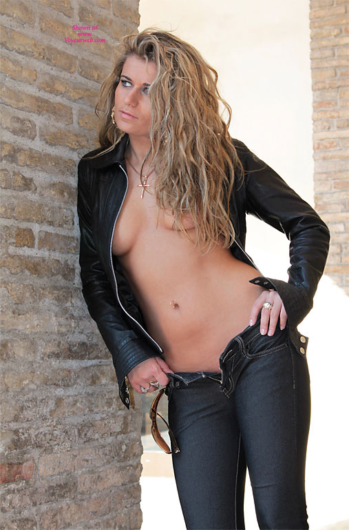 Casually Topless, Standing - Blonde Hair, Topless , Tight Jeans, No Bra, No Panties, Topless Leaning Against Wall, Topless Friend, Leather Jacket, Topless Blonde, Black Leather Jacket, Black Jeans, Denim And Leather