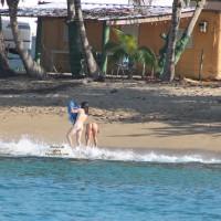 Tattooed Hottie On The Beach