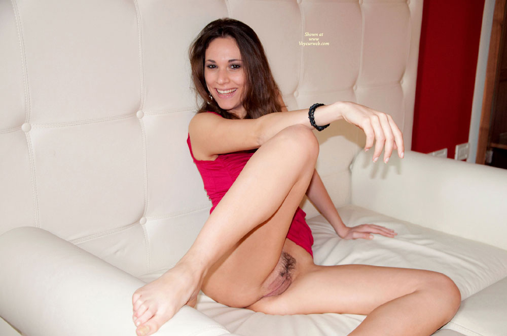 Bottomless Sexy Italian Woman - Dark Hair, Landing Strip, Red Hair, Spread Legs, Sexy Woman , Red Top, Hoop Earrings, Hot Pink Twolly, Pantieless Girl, Black Bracelet, Bottomless Seated On Couch, Attractive Pussy, Fushia Tank Top, Beautiful Smile