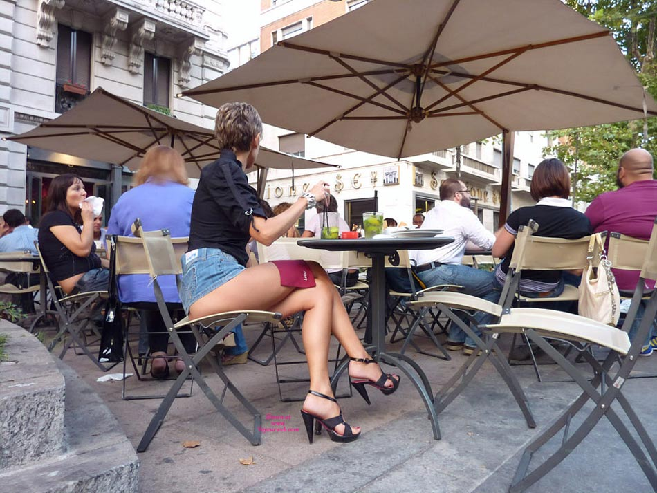 Pic #1 - Pantieless Woman In Street Cafe - Exhibitionist, Heels, Long Legs, Sexy Legs , Jeans Skirt, Skirt Pulled Up, Outdoor Cafe Legs, Denim Skirt, Bottomless Girl, Sitting In A Street Cafe, Navy Blue Top, Long Sexy Legs