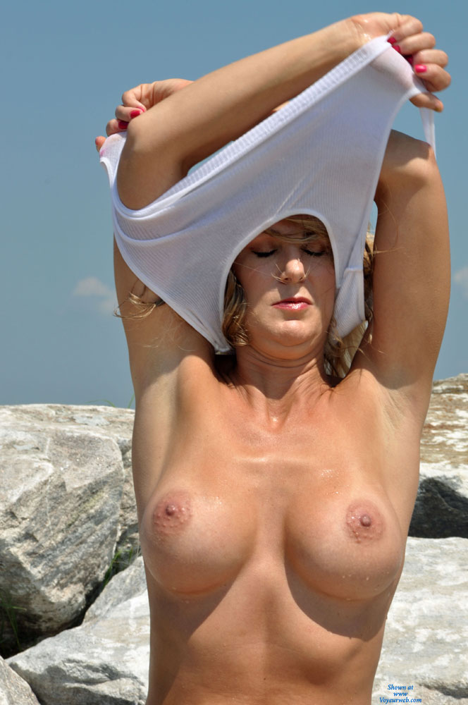 Pic #1 - Braless Girl Undressing Top - Big Tits, Firm Tits , Nude Friend, Aroused Nipples, White Top, Arms Up, Cute Face, Showing Both Armpits, Pulling White Top Over Her Head