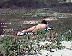 Pic #2 - Slepping      Girl on Beach