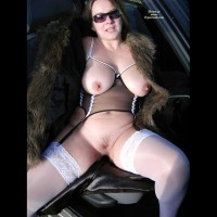 Franzi: brunette sitting in car with legs spread and tits out