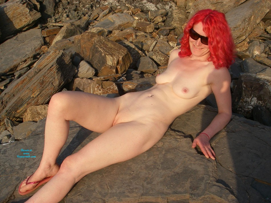Pic #1 - Daisy Gives The Local Fishermen an Eyeful - Redhead, Beach Voyeur , Daisy Had Never Really Stripped Off In Public, But The Sun And The Sea And The Gorgeous Beach Got Her In The Mood. Lots Of Guys Were Fishing On The Rocks Nearby And You Could Tell By Their Whistles And Shouts They Were Enjoying The Show!