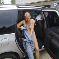 Friend Getting Changed For Surfing - Blonde