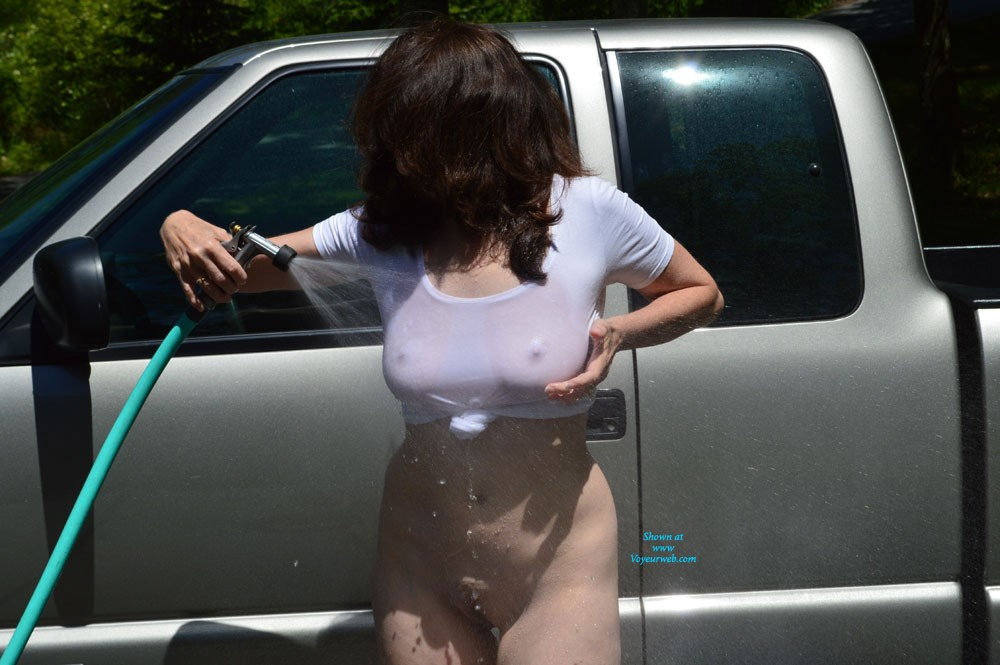 "Wash Day (Part 2) - Brunette Hair, Wet, Wife/wives , My Husband Came Outside And Started Taking Pics Of Me When He Saw Me Washing The Truck Out In The Front Yard. I Think It Was Getting Him A Little Aroused. The Cars Were Driving By And He Said, ""you Better Cover Up Before Someone Sees You"". LOL, I Don't Think They Would Mind The View. Seeing All That Water Made Me Have To Pee."