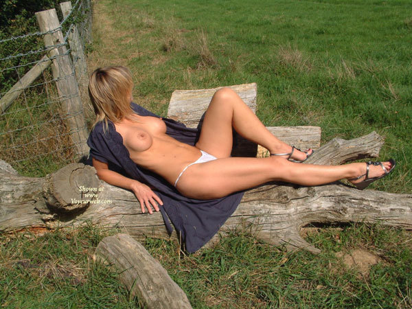 Pic #1 - Open Dress - Erect Nipples, Large Breasts, Long Legs , Perfect Measurements, Long Blue Open Top, Catching The Sun, C Cup Boobs Braless, Unbuttoned, Button Front Dress, Naked In A Field, White Thong Panties, G String, Outdoors On A Sunny Day, Long Muscular Legs, Blue Dress Half Off
