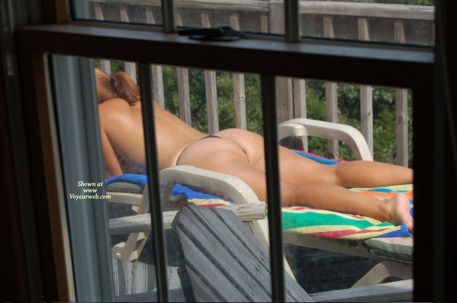 Pic #1 - Nc Beach House , I Caught This Lady Tanning One Saturday Afternoon When I Was Checking Rental Houses Damages. Turnout This Family Had House Rented For Two Weeks And Therefore Had Not Checked Out. Only Had Time To Take A Few Shots Because Her Husband Was In The Shower In The Master Suite.