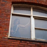 Brazen Window Girl