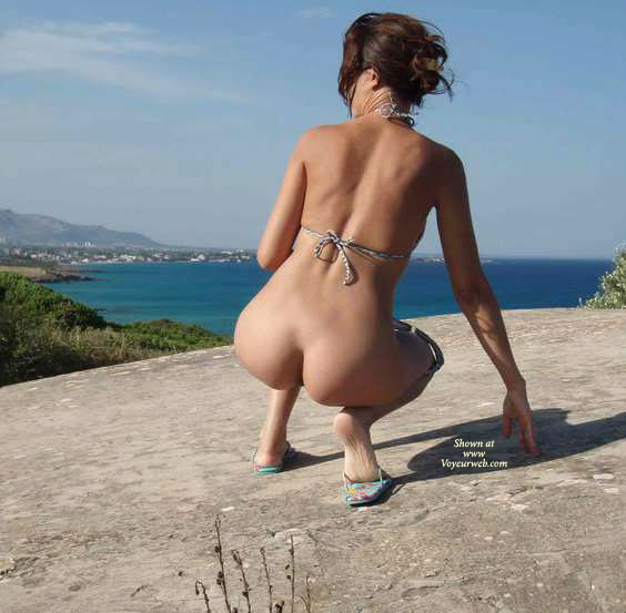 Pic #1 - Lovely Rear Cleavage , Squatting Beauty's Ass On Blue Sea, Rear View Of Bum And Back, Ocean View, Naked On Holiday, Public Butt Flash, Outdoor Photo, Crouching On Clifftop Rock, Squatting Her Naked Buns On A Rock Above The Ocean, Nice Ass Shot, Squating On Rock, Bottomless Bikini Body Outdoor Gets Down, Squatting Showing Ass, Bare Ass On Horizon