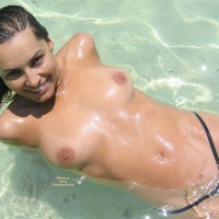 Topless Laying Back In The Surf - Black Hair, Brown Hair, Topless