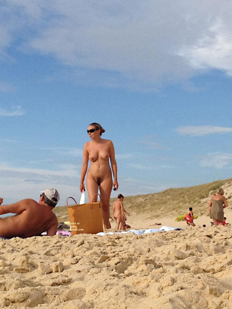 Pic #1 - Playing at The Nude Beach - Beach Voyeur , I Couldn't Resist To Take Pictures And To Film This Couple At The Nude Beach In France. Here Is A Fine Selection Of A Set Of More Than 50 Images.