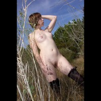 CAssy: pastey-white redhead standing in a field with puffy nipples and a golden bush