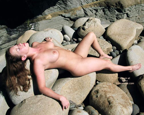 Pic #1 - Naked On Rocks - Eyes Closed, Long Hair , Naked On Rocks, Long Brown Hair, Eyes Closed, Lying On Her Back, Big Boobs On Rocks, Enjoying The Sun