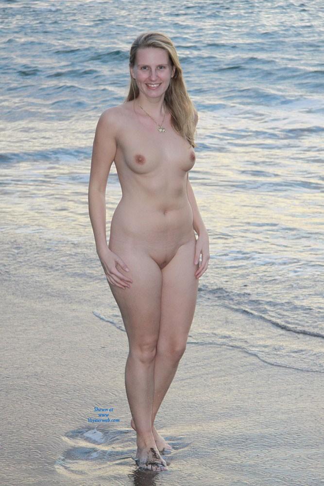 Mature pussy on beach