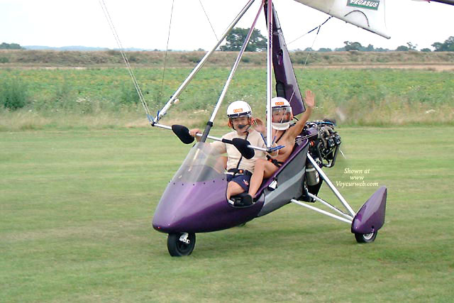 Pic #1 - Topless In Aircraft - Exhibitionist, Topless, Naked Girl, Nude Amateur , Ultralight, Action Shot, Flying Naked, With Helmet, Pilots Helmet, Topless Co-pilot, Ultralight Fun, Flying Topless, Barely Visible Nude With Man In Ultralight, Motor Glider, Flying Nude