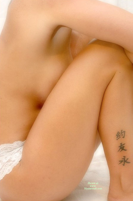 Pic #1 - Breasts Against Knees , Tattoo Showing, Knees Up Side View, Sitting Holding Her Knees, Side Close-up, Sitting With Knees Pulled Up, Side View Concealed Pose