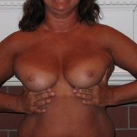 Medium tits of a neighbor - gorgeous milf