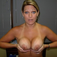Large tits of a co-worker - Lisa